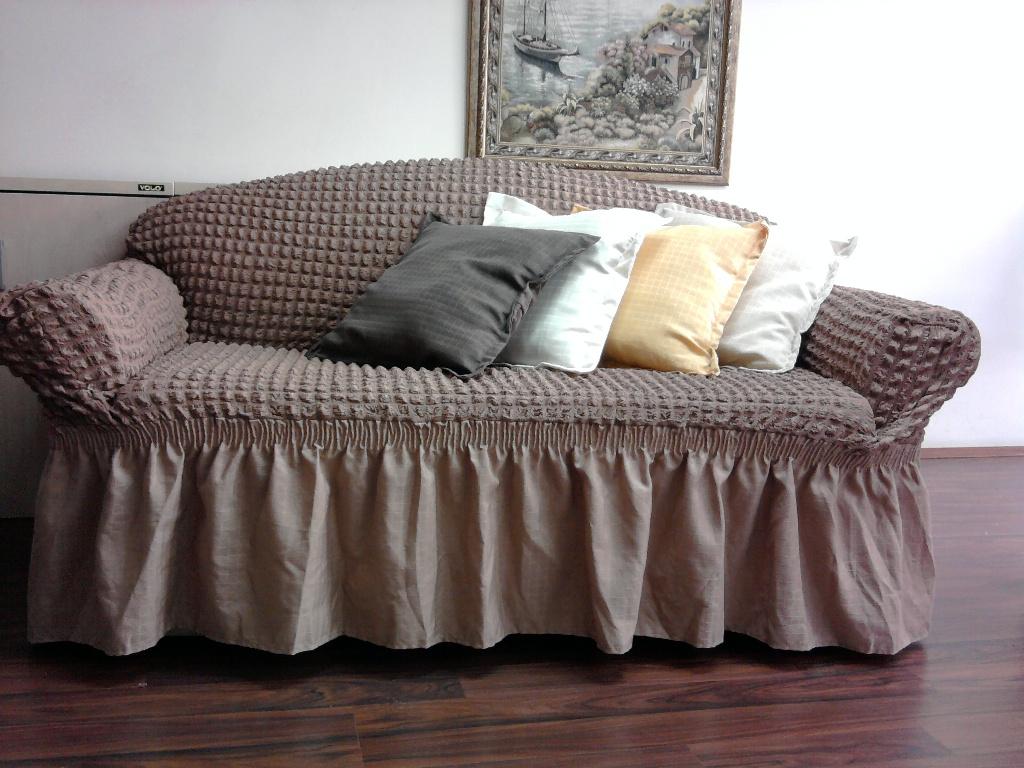 Как выглядит диван в чехле