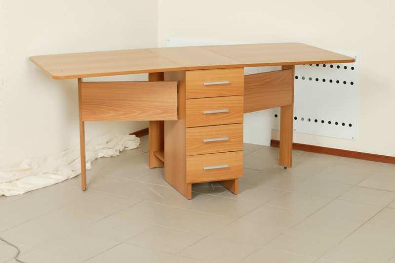 Как выглядит раскладной стол тумба