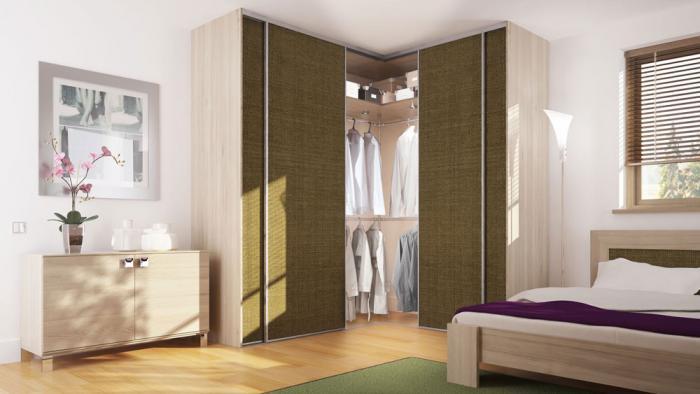 Г-образная компоновка встроенной мебели в спальне