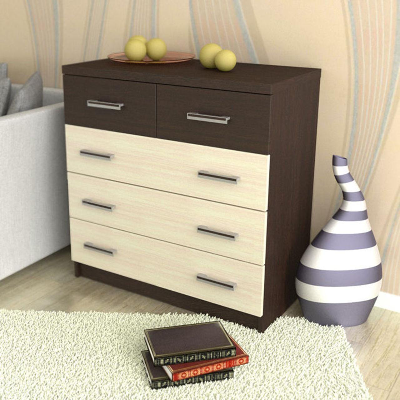 Комод представляет собой небольшой низкий шкаф с выдвижными или распашными ящиками