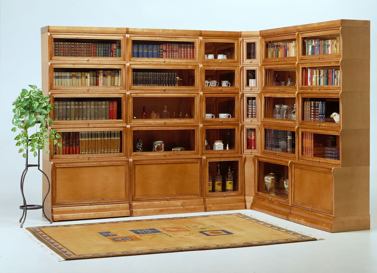 Угловой книжный шкаф предназначен для компактного хранения л.