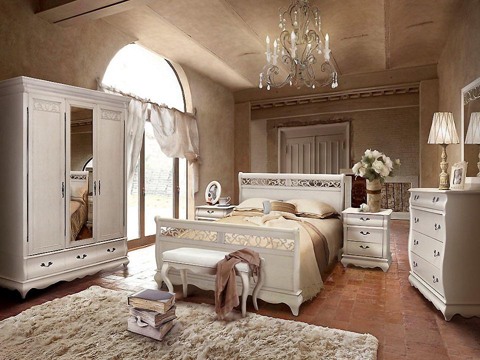 Белые цвета кровати в спальне