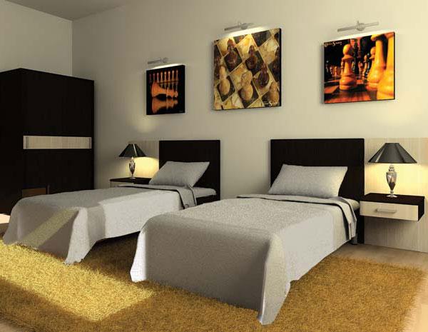 Две серые кровати для отеля