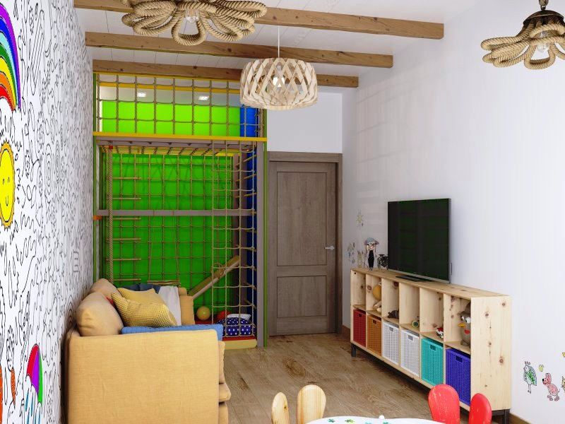 Игровая детская комната с диваном и телевизором