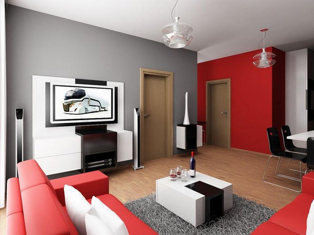 Мягкий красный диван в интерьере