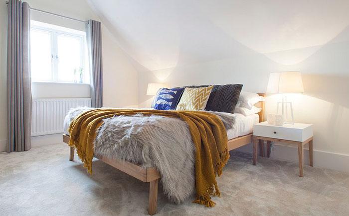 Спальня в скандинавском стиле на чердаке
