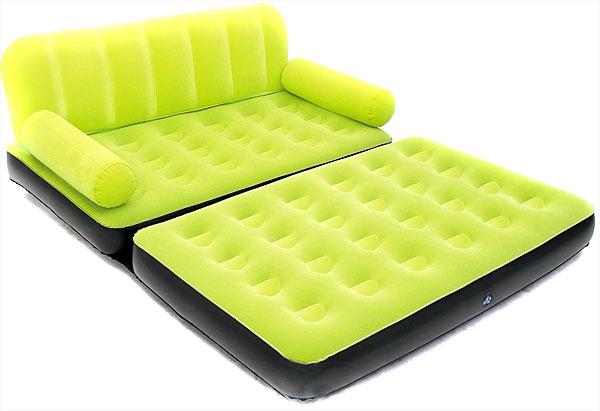 Велюровый диван-кровать зеленого цвета
