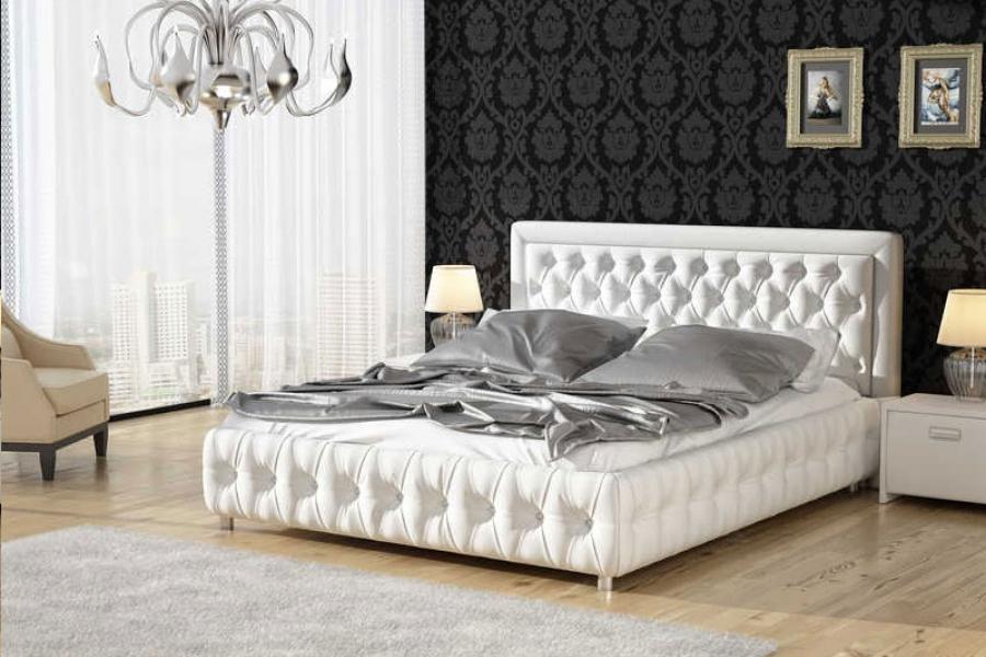 Белая кровать со стразами ос стегаными элементами
