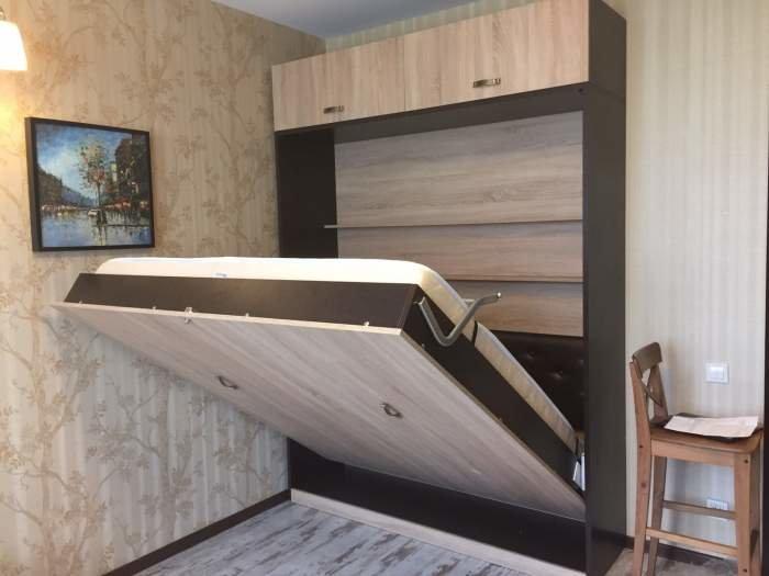 Подъемная кровать для небольшой спальни