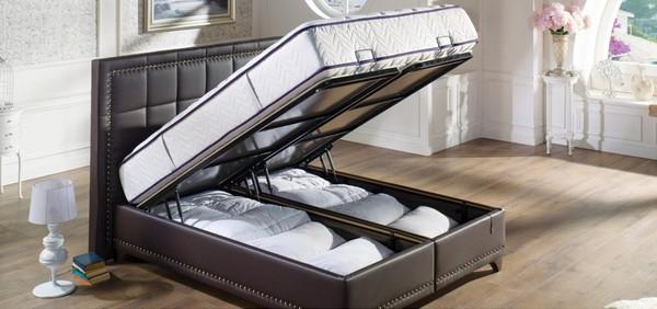 Кровать с местом для хранения постельных принадлежностей