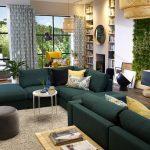 Темно-зеленый диван в интерьере гостиной