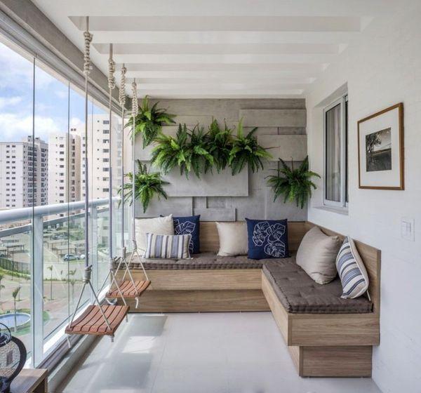Угловой диван и качели на балконе