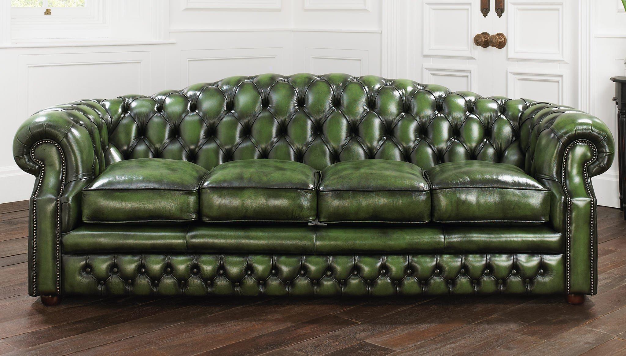 Зеленый диван с обивкой из кожи